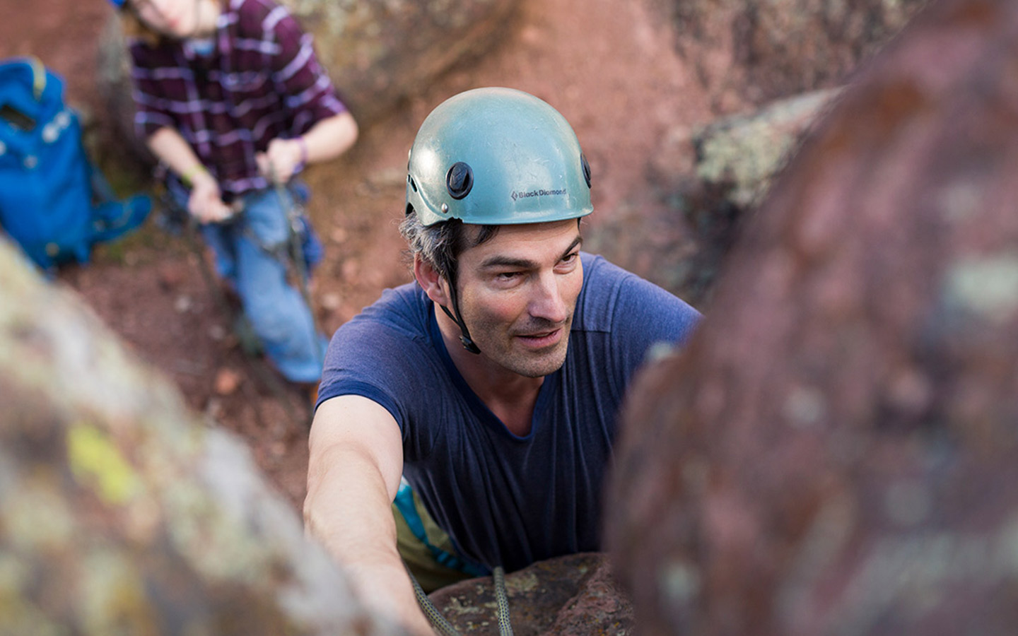 Cochlear recipient Mattias rock climbing with his family