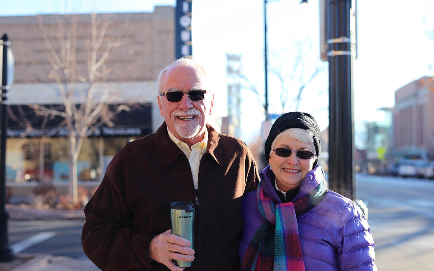 Cochlear recipient Tom and his wife Brenda pose for a photo on the street