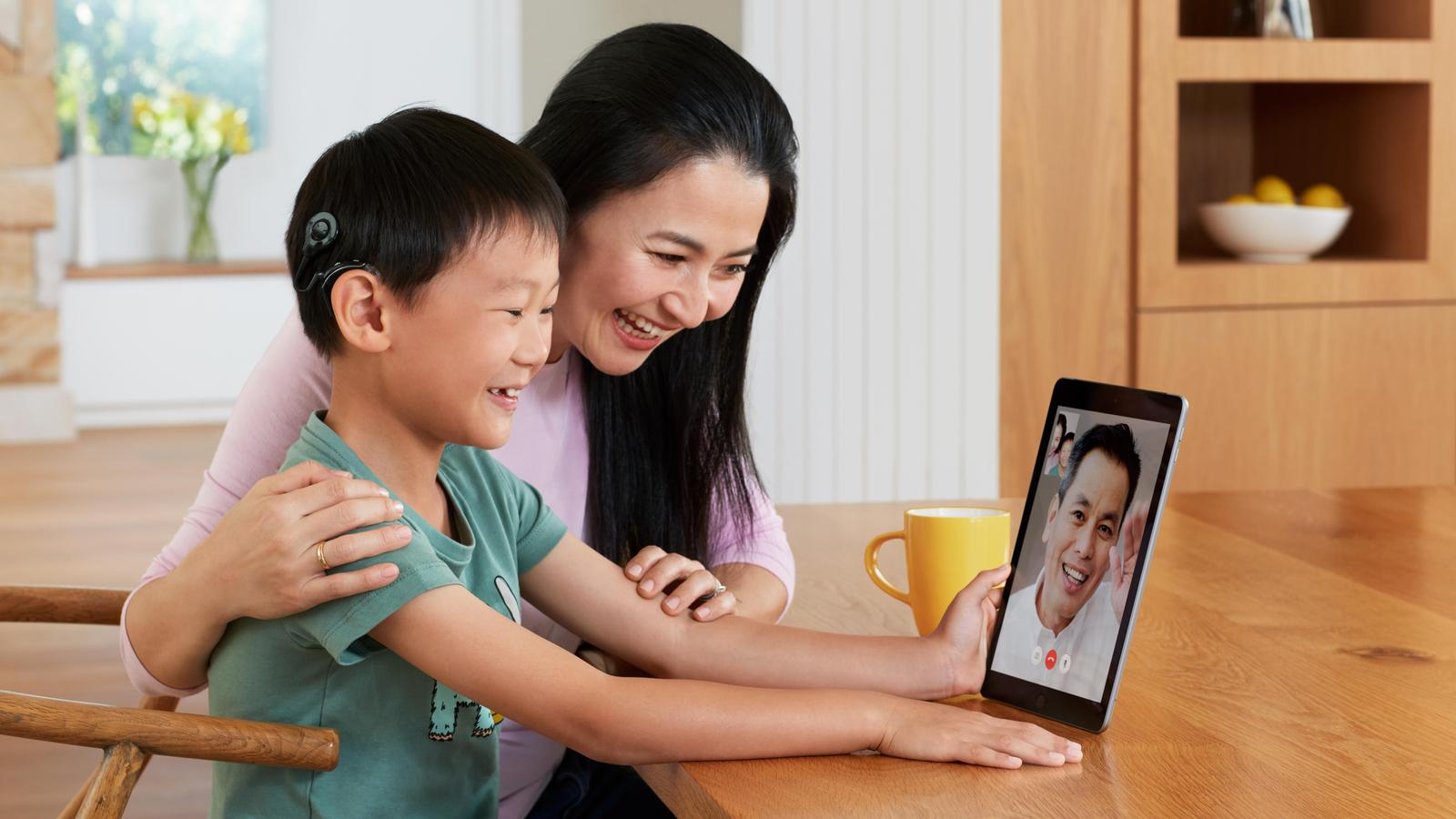 A family speak to each other via an iPad