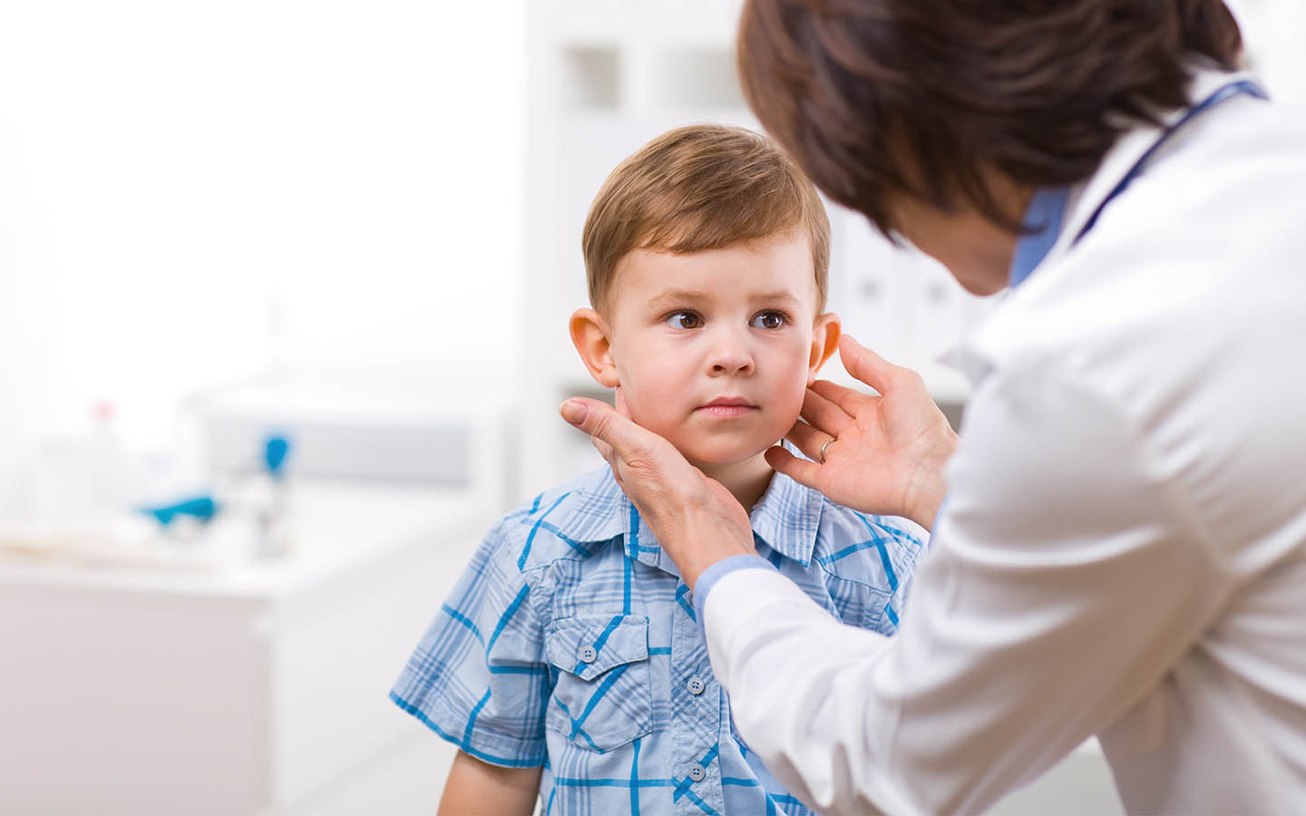 Child getting his ear checked with an audiologist
