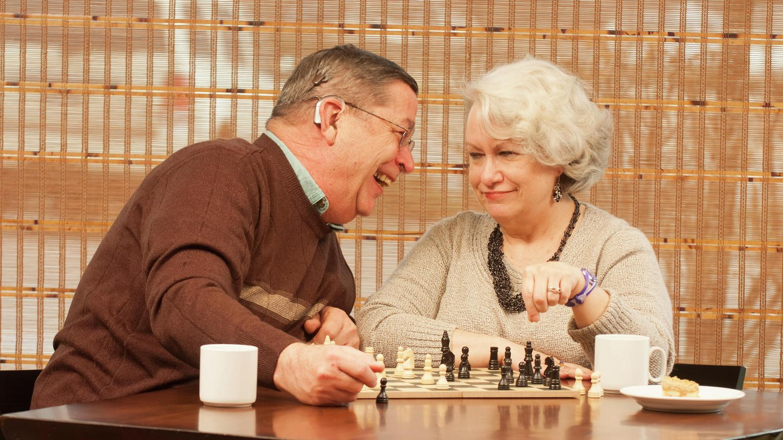 Recipient Bill and wife Pam having fun playing chess game