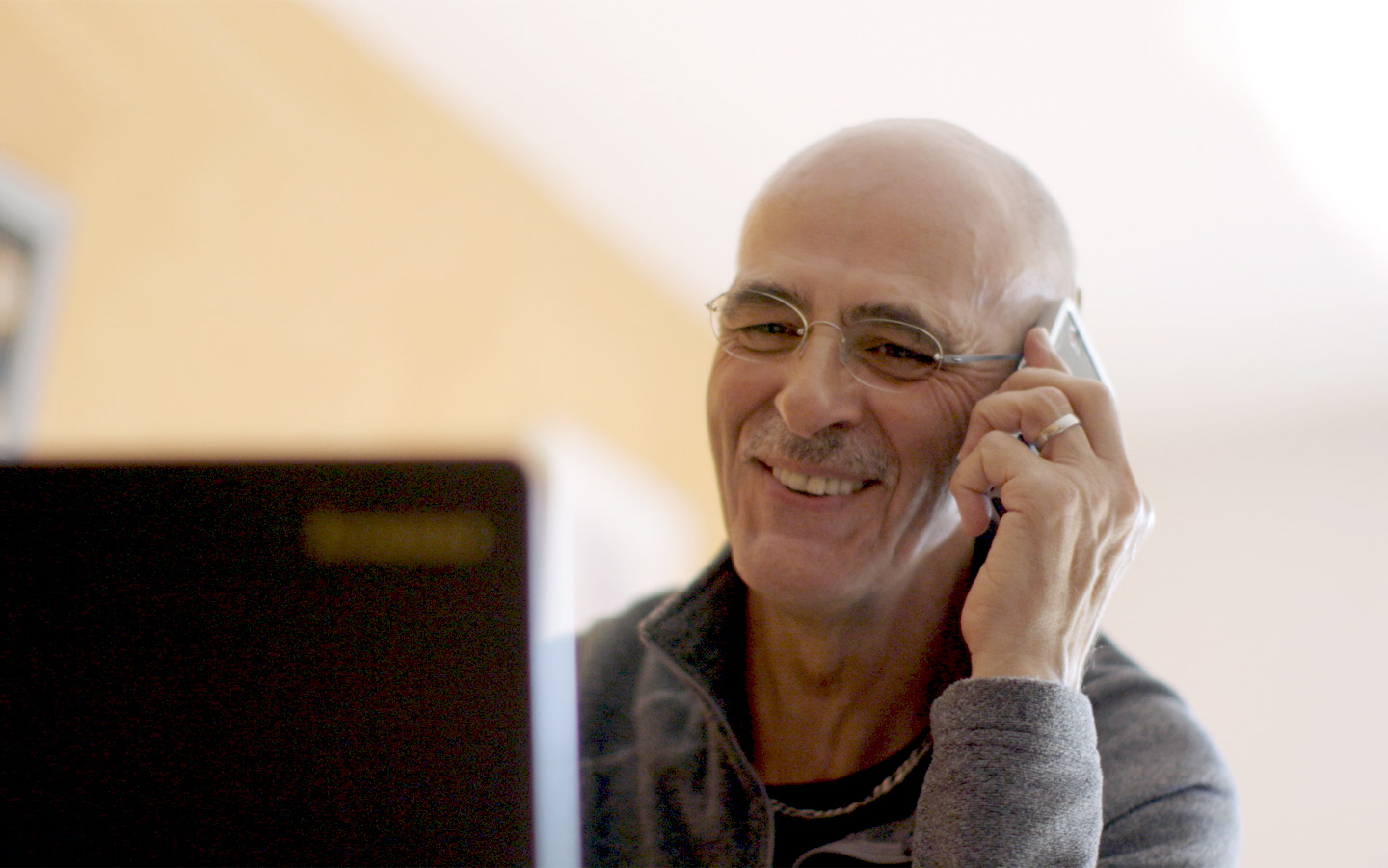 A Cochlear implant recipient talks on the phone